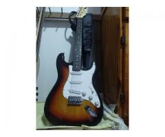 Guitarra Memphis Stratocaster + Pedalera Zoom G1