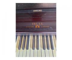 """Vendo hermoso Piano vertical """"Bell Guelph Canadá """""""